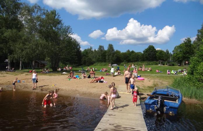 Värnamo in Småland: the bathing place Hjortsjöbadet on Lake Helgasjön in Rydaholm, near the Riksväg 27 national road