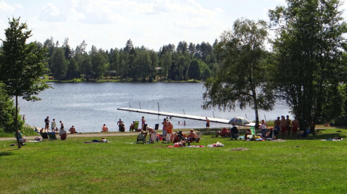 Värnamo in Småland: the bathing place Hjortsjöbadet on Lake Helgasjön in Rydaholm, near the Riksväg 27 national road